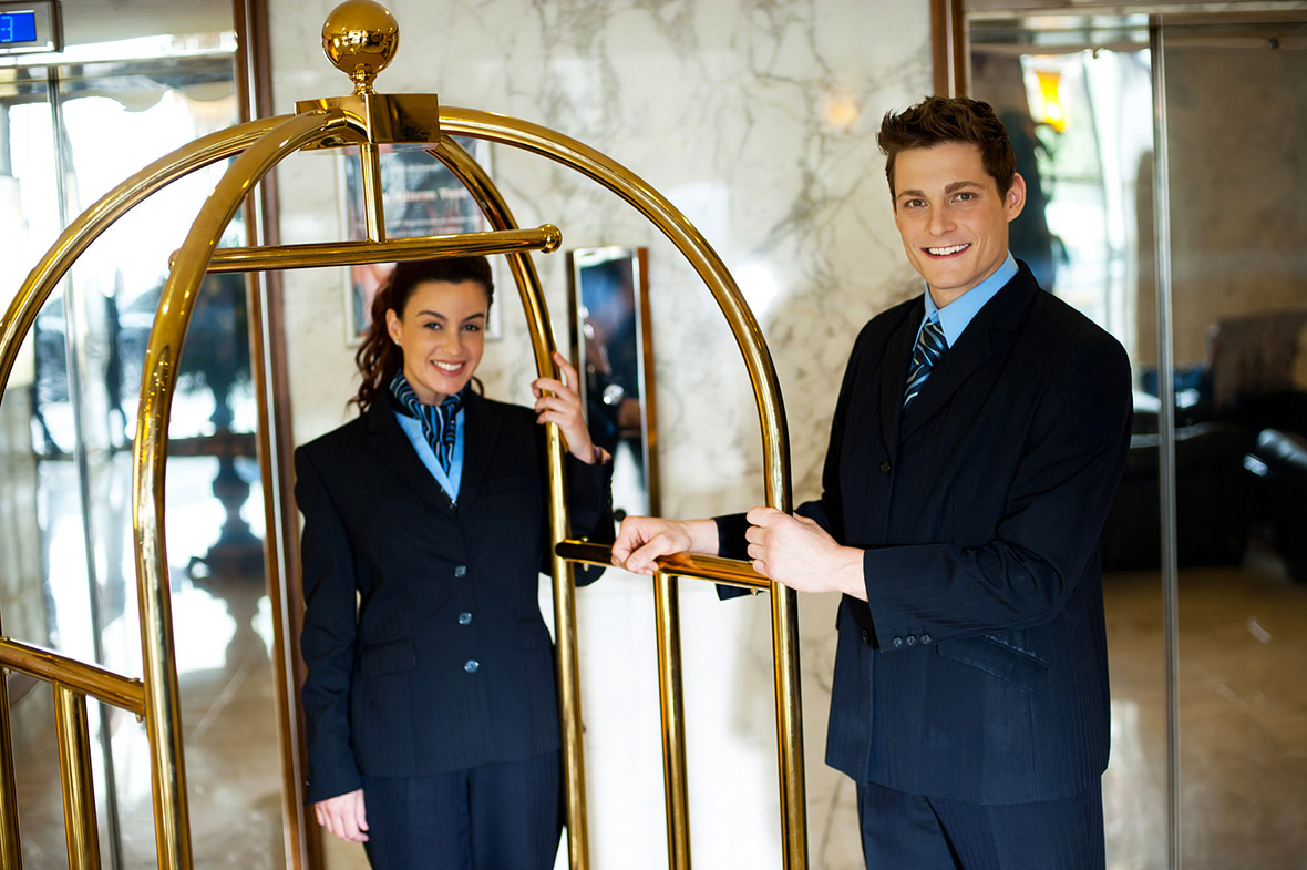 photodune-3290449-concierges-holding-the-cart-and-posing-m